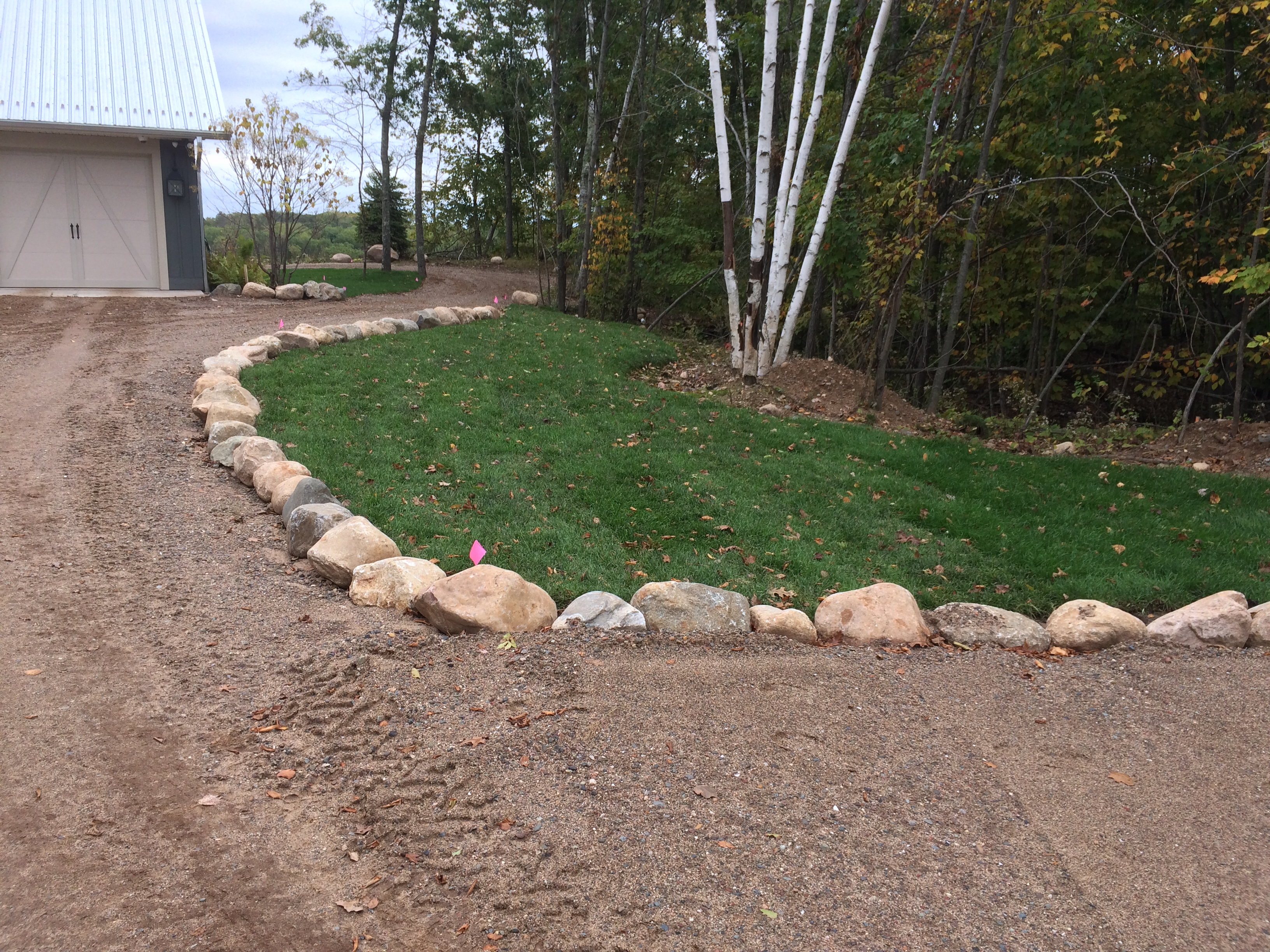 boulder edging along driveway