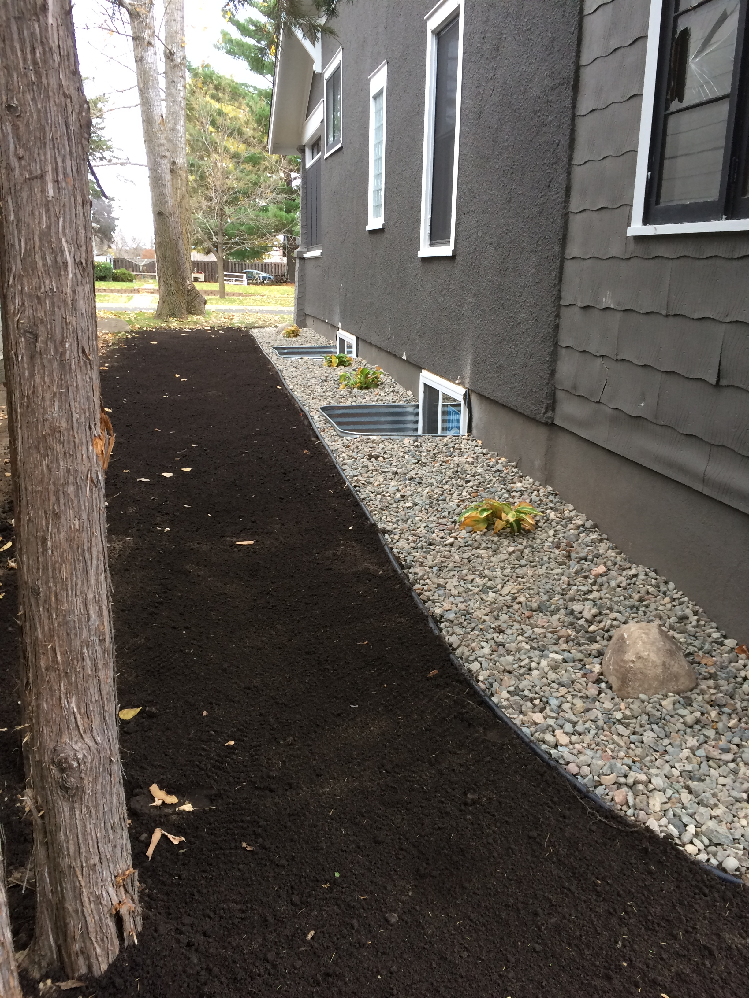 landscape bed with rock and shrubs