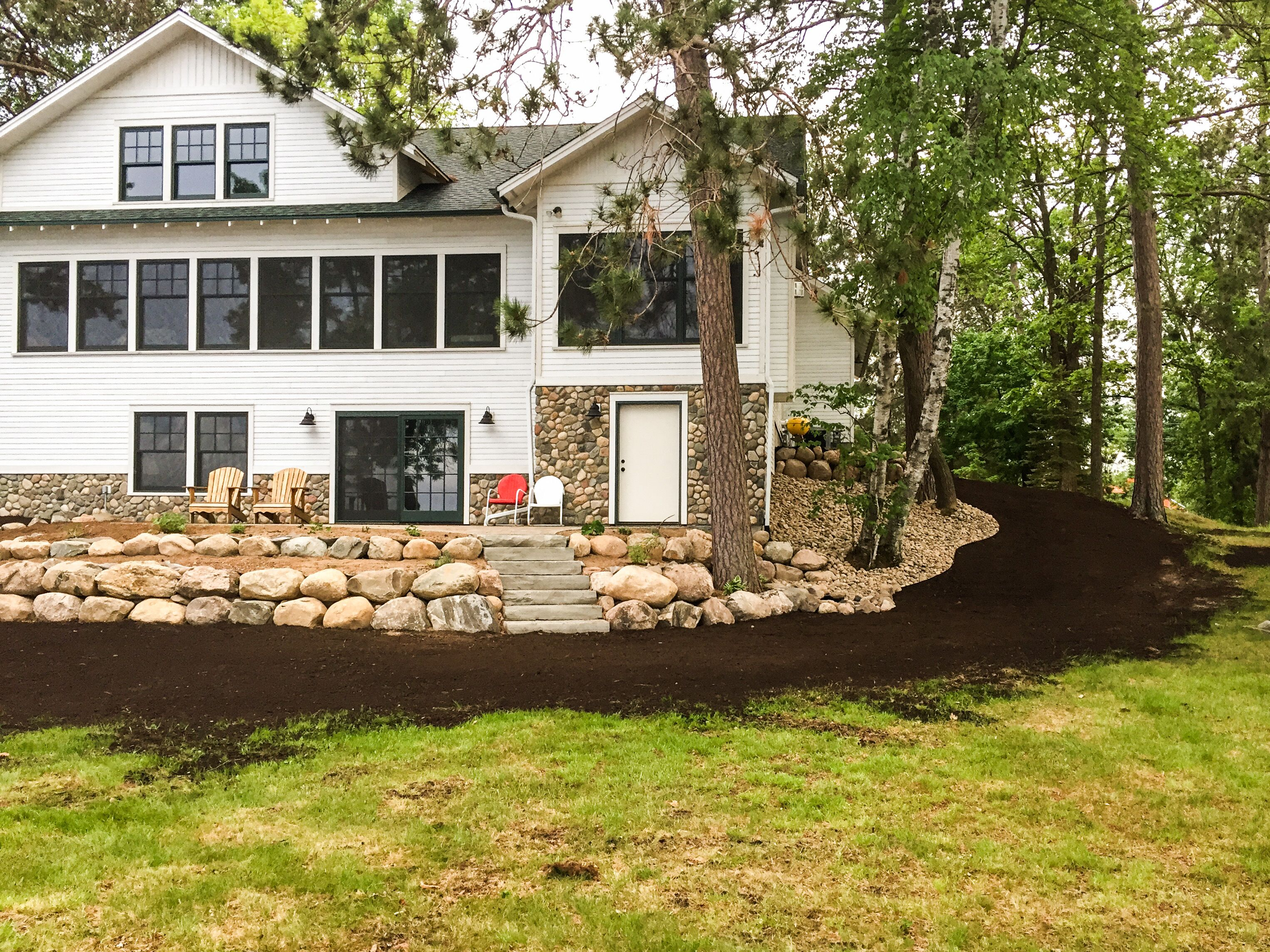 landscaping with boulder wall and paver patio