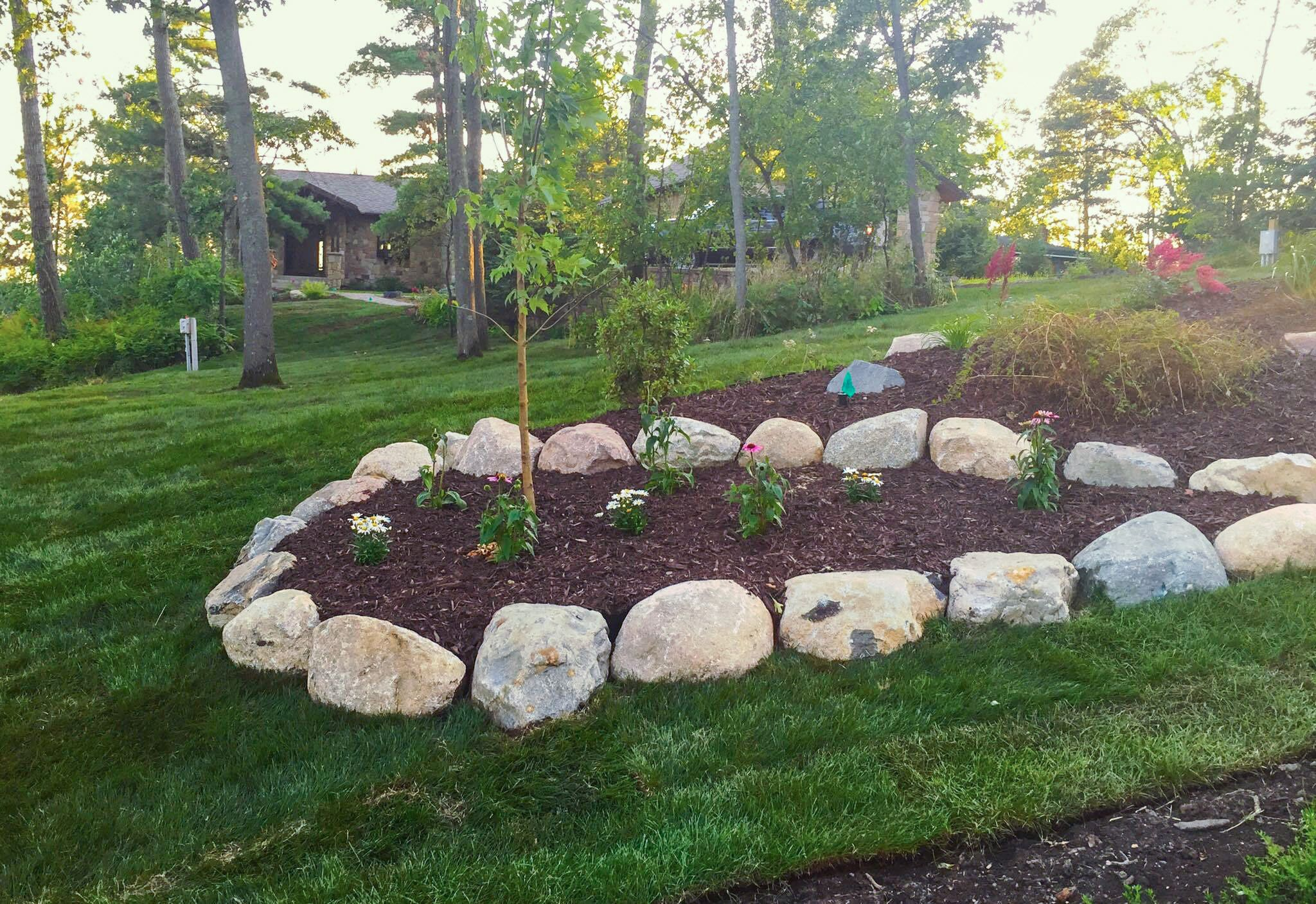 landcaping with mulch boulders