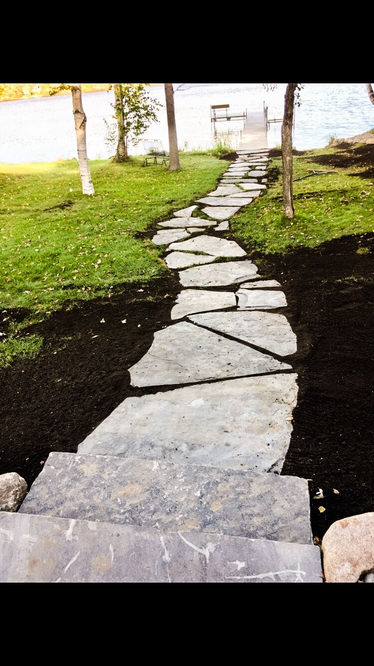 natural stone walking path to lake