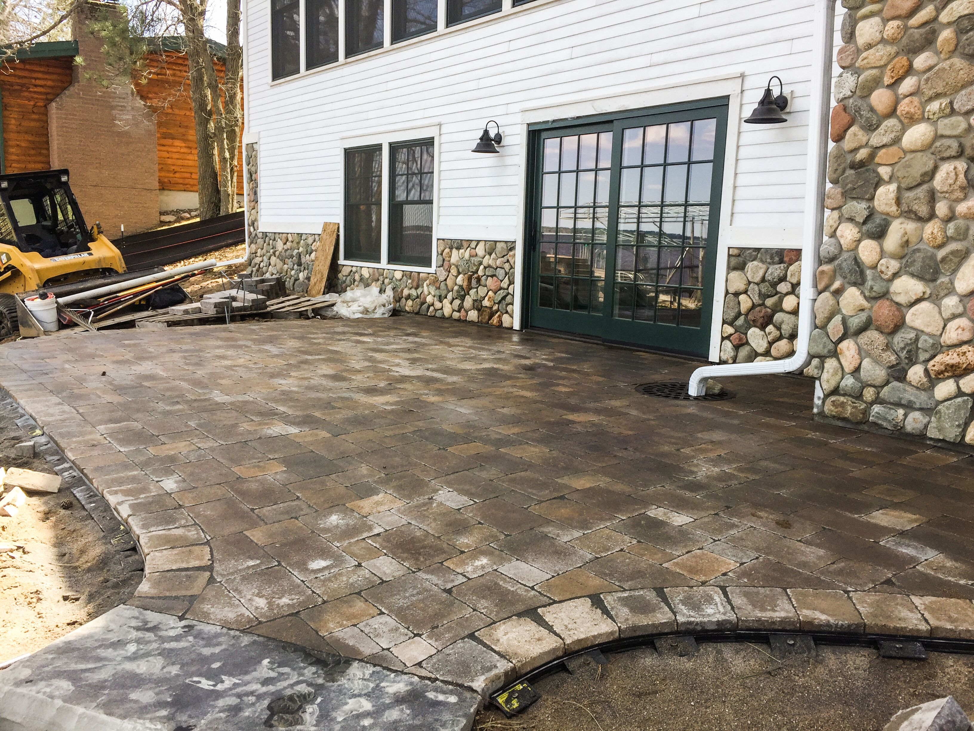 custom paver patio with drain til