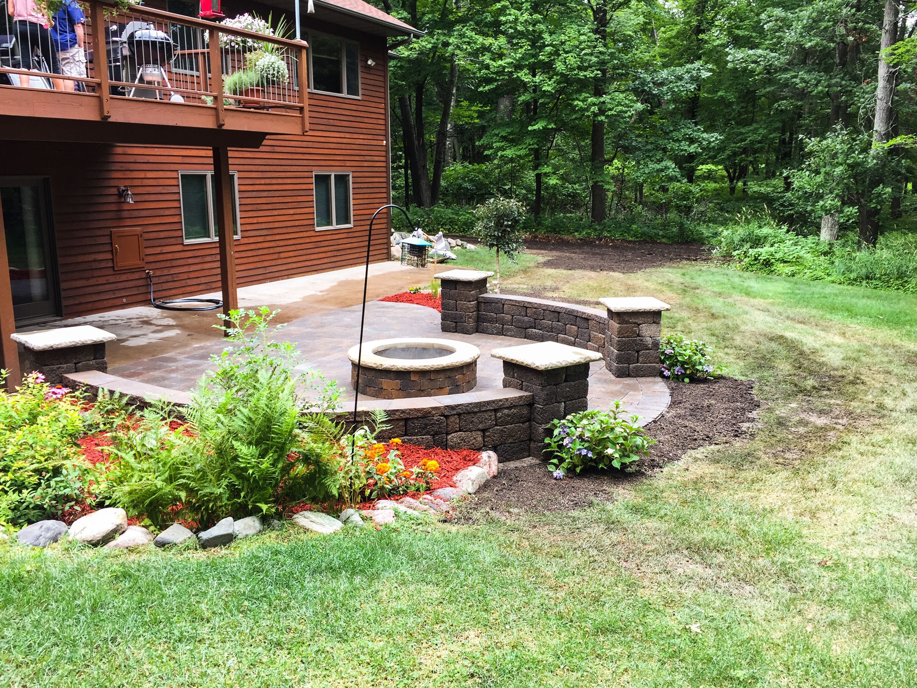 patio with shrubs and mulch