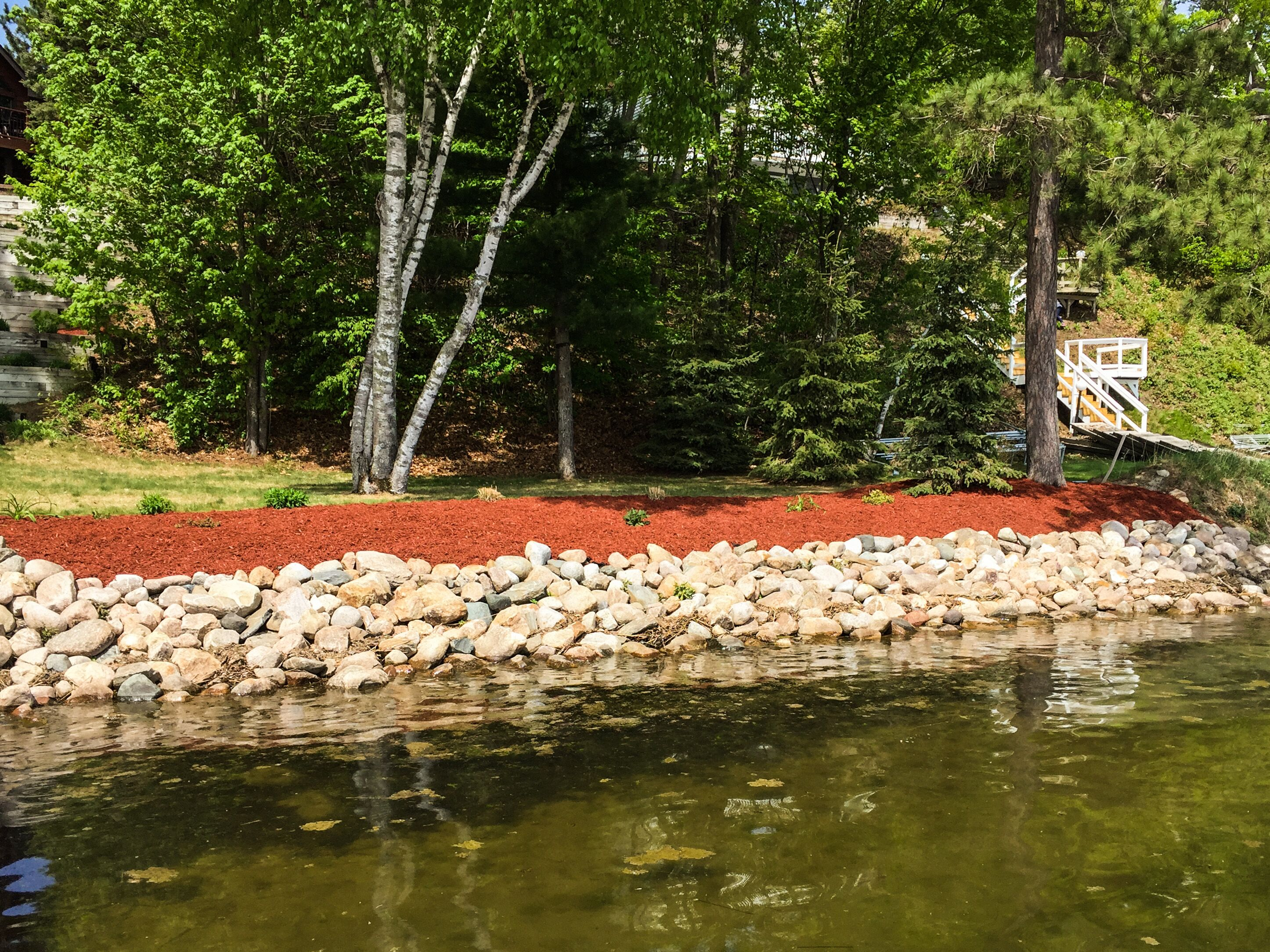 shoreline restoration with red mulch landscape